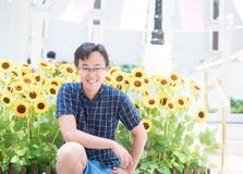 Man with the sunflower stock photography