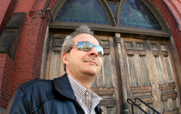 Man in sunglasses. In front of the church royalty free stock photos