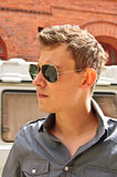 Man with sunglasses. Portrait of a beautiful young man Royalty Free Stock Photos