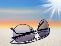 Man sunglasses. On colored surreal sky background stock image
