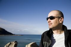 Man In Sunglasses. Near The Ocean Stock Image