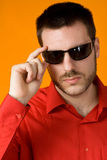 Man with Sunglasses. Handsome young man in red shirt wearing sunglasses Royalty Free Stock Photo