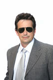 Man in sunglasses. Man in suit with sunglasses over white background Royalty Free Stock Photography