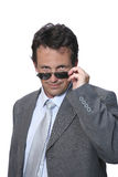 Man in sunglasses. Man in suit with sunglasses over white background Stock Images
