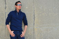 Man in Sunglasses Against Concrete Wall Stock Image