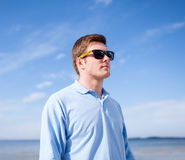 Man in sunglasses on the beach Stock Image