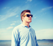 Man in sunglasses on the beach Royalty Free Stock Images