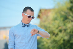 Man with sunglasses checking time Royalty Free Stock Photos