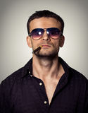 Man in sunglasses with a cigar Royalty Free Stock Photos