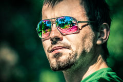 Man in sunglasses with colourful reflection Stock Photo