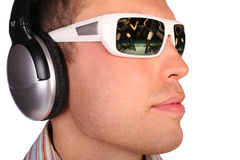 Man with sunglasses and headphones Stock Image