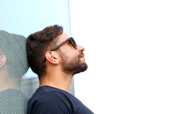 Man with sunglasses looking to the sky Royalty Free Stock Photo