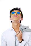 Man in sunglasses looking up Stock Photography