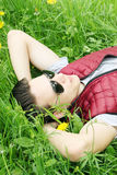 Man in sunglasses lying on the grass Royalty Free Stock Images