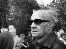 Man in sunglasses at May Day march Royalty Free Stock Images