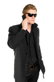 Man in sunglasses with a mobile Royalty Free Stock Photos