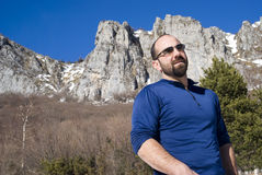 Man with sunglasses in the mountains Stock Images