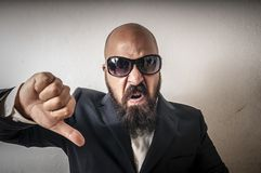 Man with sunglasses and negative expressio Royalty Free Stock Photography