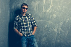 Man in sunglasses and plaid shirt Royalty Free Stock Image