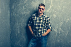 Man in sunglasses and plaid shirt Royalty Free Stock Photography