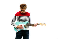 Man in sunglasses playing on the guitar Stock Images