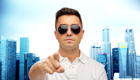 Man in sunglasses pointing finger on you Royalty Free Stock Photos