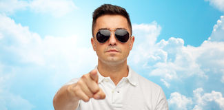 Man in sunglasses pointing finger on you Royalty Free Stock Image