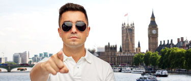 Man in sunglasses pointing finger on you Stock Image