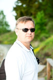 Man with sunglasses and polo shirt Stock Image