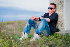 Man in sunglasses relaxing on nature Royalty Free Stock Images
