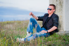 Man in sunglasses relaxing on nature Stock Photography