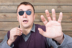 Man with sunglasses represents the blind person Royalty Free Stock Images