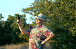 Man in sunglasses with revolver Stock Photography