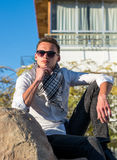 Man in sunglasses and in a shirt, in a keffiyeh Royalty Free Stock Photos