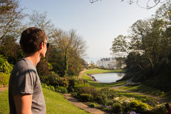 Man in sunglasses standing in the park Stock Photography