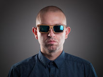 Man with sunglasses in a studio shot Royalty Free Stock Image