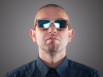 Man with sunglasses in a studio shot Stock Image