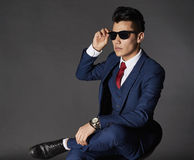 Man with sunglasses and suit Royalty Free Stock Photo