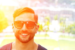 Man with sunglasses in the sun. Portrait of a young man with sunglasses in the sun Stock Photos