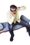 Man with sunglasses talking on cell phone Royalty Free Stock Photos
