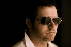 Man in Sunglasses thinks Deeply Stock Photo