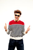 Man in sunglasses with thumbs up Stock Images