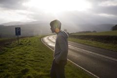 Man On Sunlit Road. A Man On Sunlit Country Road Royalty Free Stock Images