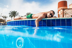 The man sunning by the pool. In sunny day royalty free stock photos