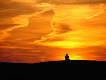 Man and sunset. Man relax on sunset background stock photos