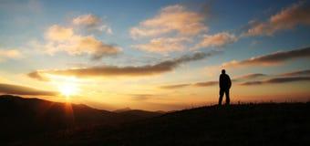 Man on the sunset background royalty free stock image