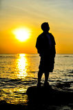 Man in sunset. A man in sunset background Stock Image