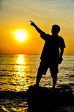 Man in sunset. A man in sunset background Stock Photography
