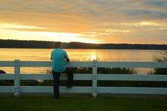 Man sunset fence Stock Image