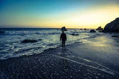 Man at sunset in malibu Stock Images